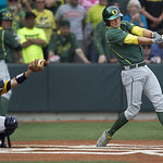Oregon's Ryan Healy's base hit  in the top of the 8th tied the game at two. Kent State defeated  Oregon 3-2 in an NCAA Super Regional to advance to the College World Series.(AP Photo/The Ore …