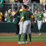 Oregon's Ryon Healy is consoled by teammate Thomas Walker, rear, as the Ducks absorb a ninth inning loss to Kent State in the final game of their NCAA college baseball tournament super regio …