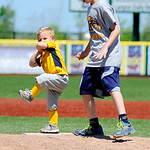 Xavier Marconi, 2, the son of Kent State's head coach, tests his skills at the mound with the help of Nate Boozer, 9, of Stow. KRISTIN BAUER | CHRONICLE