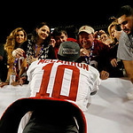 Alabama 's AJ McCarron (10) celebrates with fans after the BCS National Championship college football game against Notre Dame Monday, Jan. 7, 2013, in Miami. Alabama won 42-14. (AP Photo/Joh …