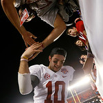 Alabama's AJ McCarron celebrates with fans after the BCS National Championship college football game against Notre Dame Monday, Jan. 7, 2013, in Miami. Alabama won 42-14. (AP Photo/John Baze …