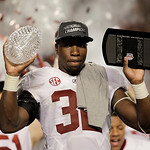 Alabama's C.J. Mosley holds up The Coaches' Trophy after the BCS National Championship college football game against Notre Dame Monday, Jan. 7, 2013, in Miami. Alabama won 42-14. (AP Photo/C …