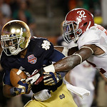Notre Dame's Theo Riddick catches a touchdown pass in front of Alabama's C.J. Mosley (32)during the second half of the BCS National Championship college football game Monday, Jan. 7, 2013, i …