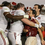 Alabama head coach Nick Saban is hugged by AJ McCarron, Barrett Jones and Cyrus Kouandjio after the BCS National Championship college football game against Notre Dame Monday, Jan. 7, 2013, i …