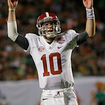 Alabama quarterback AJ McCarron celebrates during the second half of the BCS National Championship college football game against Notre Dame Monday, Jan. 7, 2013, in Miami. (AP Photo/David J. …