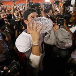 Alabama's AJ McCarron kisses The Coaches Trophy after the BCS National Championship college football game against Notre Dame Monday, Jan. 7, 2013, in Miami. Alabama won 42-14. (AP Photo/John …