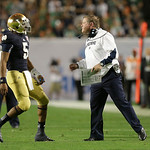 Notre Dame quarterback Everett Golson (5) speaks to Notre Dame head coach Brian Kelly during the second half of the BCS National Championship college football game against Alabama, Monday, J …