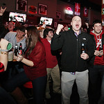Alabama fans react to a first-quarter touchdown against Notre Dame as they watch a television broadcast of the BCS National Championship college football game, Monday, Jan. 7, 2013, at Hound …
