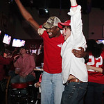 Alabama fans Andre Hague, left, and Mica Bousheri react to a first-quarter touchdown against Notre Dame as they watch a television broadcast of the BCS National Championship college football …