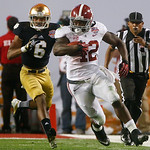 Alabama's Eddie Lacy (42) runs past Notre Dame cornerback KeiVarae Russell during the second half of the BCS National Championship college football game Monday, Jan. 7, 2013, in Miami. (AP P …