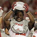Alabama's Eddie Lacy holds up the championship trophy after the BCS National Championship college football game against Notre Dame Monday, Jan. 7, 2013, in Miami. Alabama won 42-14. (AP Phot …