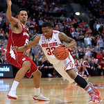 Ohio State's Lenzelle Smith, right, drives to the basket against Wisconsin's Ryan Evans during the second half of an NCAA college basketball game Tuesday, Jan. 29, 2013, in Columbus, Ohio. O …