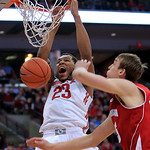 Ohio State's Amir Williams, left, dunks over Wisconsin's Sam Dekker during the second half of an NCAA college basketball game Tuesday, Jan. 29, 2013, in Columbus, Ohio. Ohio State defeated W …