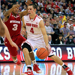 Ohio State's Aaron Craft, right, drives the lane against Wisconsin's George Marshall during the second half of an NCAA college basketball game Tuesday, Jan. 29, 2013, in Columbus, Ohio. Ohio …
