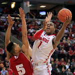 Ohio State's Deshaun Thomas, right, shoots over Wisconsin's Ryan Evans during the second half of an NCAA college basketball game Tuesday, Jan. 29, 2013, in Columbus, Ohio. Ohio State defeate …