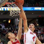 Ohio State's Aaron Craft, right, shoots over Wisconsin's Sam Dekker during the second half of an NCAA college basketball game Tuesday, Jan. 29, 2013, in Columbus, Ohio. Ohio State defeated W …