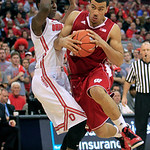 Wisconsin's Traevon Jackson, right, drives to the basket against Ohio State's Shannon Scott during the first half of an NCAA college basketball game Tuesday, Jan. 29, 2013, in Columbus, Ohio …