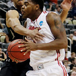 Loyola (Md.)&#039;s Erik Etherly, left, fouls Ohio State&#039;s Deshaun Thomas during the second half of an NCAA tournament second-round college basketball game in Pittsburgh, Thursday, March 15, 2012 &#8230;