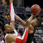 Loyola of Maryland&#039;s Dylon Cormier, right, cannot get a shot over Ohio State&#039;s Jared Sullinger during the first half of an NCAA tournament second-round college basketball game in Pittsburgh, &#8230;