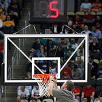A worker at the Consol Energy Center fixes the net on one of the baskets in the first half of an NCAA tournament second-round college basketball game between Ohio State and Loyola of Marylan &#8230;