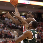 Ohio State's Evan Ravenel shoots over Michigan State's Derrick Nix during the first half of an NCAA college basketball game Sunday, Feb. 24, 2013, in Columbus, Ohio. (AP Photo/Jay LaPrete)
