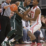 Michigan State's Branden Dawson, left, looks to pass as Ohio State's Sam Thompson defends during the first half of an NCAA college basketball game Sunday, Feb. 24, 2013, in Columbus, Ohio. ( …