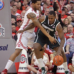 Michigan State's Derrick Nix, right, posts up against Ohio State's Amir Williams during the first half of an NCAA college basketball game Sunday, Feb. 24, 2013, in Columbus, Ohio. (AP Photo/ …