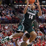 Michigan State's Gary Harris, top, shoots over Ohio State's Deshaun Thomas during the second half of an NCAA college basketball game Sunday, Feb. 24, 2013, in Columbus, Ohio. Ohio State beat …