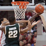 Ohio State's Amir Williams, left, fouls Michigan State's Branden Dawson during the first half of an NCAA college basketball game Sunday, Feb. 24, 2013, in Columbus, Ohio. (AP Photo/Jay LaPre …
