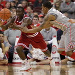 Indiana's Victor Oladipo, left, grabs a loose ball away from Ohio State's Lenzelle Smith during the second half of an NCAA college basketball game on Sunday, Feb. 10, 2013, in Columbus, Ohio …