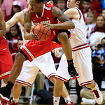 Ohio State's Lenzelle Smith Jr., center, grabs a rebound against Indiana's Jordan Hulls during the second half of an NCAA college basketball game, Tuesday, March 5, 2013, in Bloomington, Ind …