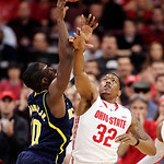 Ohio State's Lenzelle Smith Jr., (32) blocks a shot by Michigan's Tim Hardaway Jr., (10) during the first half of an NCAA college basketball game, Sunday, Jan. 13, 2013, in Columbus, Ohio. ( …