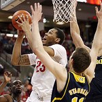 Ohio State's Amir Williams (23) shoots surrounded by Michigan defenders during the first half of an NCAA college basketball game on Sunday, Jan. 13, 2013, in Columbus, Ohio. (AP Photo/Mike M …