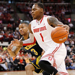 Ohio State's DeShaun Thomas (1) drives as Michigan's Trey Burke (3) tries to keep up during the first half of an NCAA college basketball game Sunday, Jan. 13, 2013 in Columbus, Ohio. Ohio St …