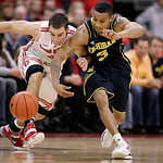 Ohio State's Aaron Craft (4) and Michigan's Trey Burke (3) vie for control of the ball during the second half of an NCAA college basketball game Sunday, Jan. 13, 2013, in Columbus, Ohio. Ohi …