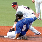 Washington's #5 Michael Bando slides safely into second as the Crushers' #2 Brandon Decker places the tag.