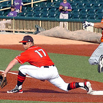 Joliet's #4 Michael Wing is safe on first as the Crushers' #17 Russell Moldenhauer waits for the ball. (CT photo by Linda Murphy.)