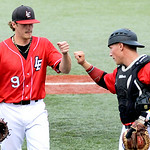 Lake Erie Crushers' pitcher Zac Treece fist bumps catcher Kevin Franchetti after a three-up, three-down inning. KRISTIN BAUER | CHRONICLE