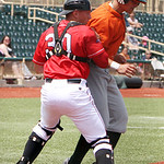 Lake Erie Crushers catcher Kevin Franchetti tags out the runner at home. ANNA NORRIS/CHRONICLE