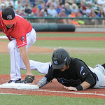 Lake Erie Crushers' first baseman Joey Burney tags out Windy City ThunderBolts' Garrett Carey. KRISTIN BAUER | CHRONICLE