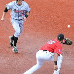 After Lake Erie Crusher's second baseman Matt Dickason caught a line-drive, he quickly threw the ball to first baseman Vincent Mejia to tag out Washington Wild Things' Daniel Poma. KRISTIN B …