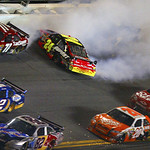 Jeff Gordon (24) crashes as Bobby Labonte (71), Kurt Busch (2), Scott Speed (82), Joey Logano (20), Tony Stewart (14) and Elliott Sadler (19) drive past during the final laps of the NASCAR D …