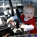 Trace McDowell, 1, son of driver Michael McDowell, sits in his father's race car before the start of the NASCAR Daytona 500 auto race at Daytona International Speedway in Daytona Beach, Fla. …