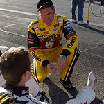 Clint Bowyer, top, talks with Kasey Kahne during a delay of more than an hour and a half in the Daytona 500 NASCAR auto race at Daytona International Speedway in Daytona Beach, Fla., Sunday, …