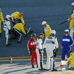 NASCAR and track officials try to repair a hole in the track during the NASCAR Daytona 500 auto race at Daytona International Speedway in Daytona Beach, Fla., Sunday, Feb. 14, 2010. (AP Phot …