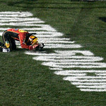 Jamie McMurray kneels on the grass after winning the NASCAR Daytona 500 auto race at Daytona International Speedway in Daytona Beach, Fla., Sunday, Feb. 14, 2010. (AP Photo/David Graham)