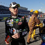 Carl Edwards stands on pit road during a delay of more than an hour and a half in the Daytona 500 NASCAR auto race at Daytona International Speedway in Daytona Beach, Fla., Sunday, Feb. 14, …