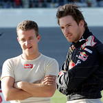 AJ Allmendinger, left, and Scott Speed, right, talk during a red flag in the NASCAR Daytona 500 auto race at Daytona International Speedway in Daytona Beach, Fla., Sunday, Feb. 14, 2010. (AP …