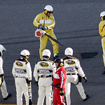 Track workers try to repair a hole in the track as NASCAR officials look on during a red flag in the NASCAR Daytona 500 auto race at Daytona International Speedway in Daytona Beach, Fla., Su …