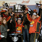 Jamie McMurray, center, with crew, celebrates in victory lane after winning the Daytona 500 NASCAR auto race at Daytona International Speedway in Daytona Beach, Fla., Sunday, Feb. 14, 2010. …